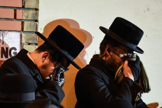 Two men wipe their eyes during the funeral of Leah Minda Ferencz on Martin Luther King Drive in Jersey City on Wednesday December 11, 2019. Ferencz is one of the victims of the fatal shooting in Jersey City.