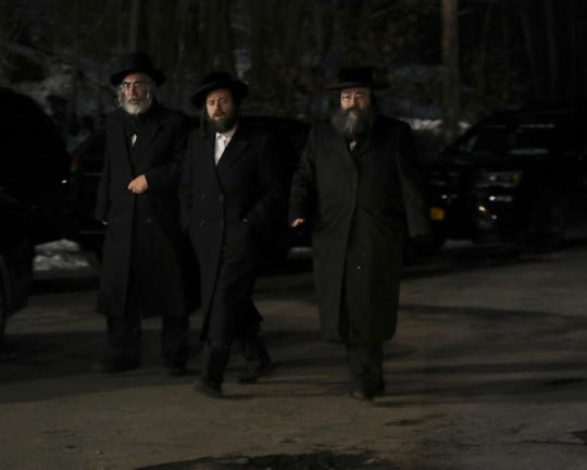Hasidic men walk towards the cemetery during the funeral for Leah Minda Ferencz and Moshe Hirsch Deutsch at the Satmar cemetery in Kiryas Joel on Thursday, December 12, 2019.  Ferencz, 32, and Deutch, 24, were both victims of Tuesday's fatal shooting in Jersey City.