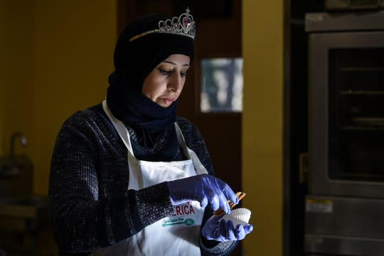 Samar Abdulbaki, 38 is one of the Syrian refugees who makes cookies for a holiday sweet treats program with United Tastes of America at the Bnai Keshet temple in Montclair on Thursday December 12, 2019.