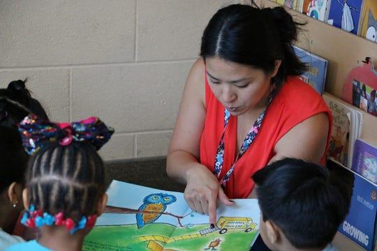 Suzanne Greenberg, a Hackensack preschool teacher, reads to students.