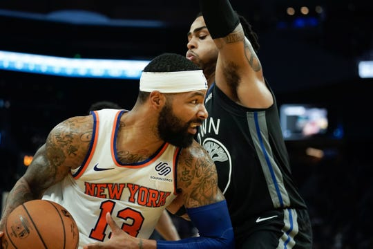 Dec 11, 2019; San Francisco, CA, USA; New York Knicks forward Marcus Morris Sr. (13) drives the ball against Golden State Warriors guard D'Angelo Russell (0) during the fourth quarter at Chase Center. Mandatory Credit: Stan Szeto-USA TODAY Sports