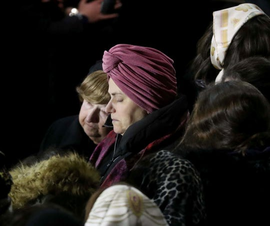 The mother of Moshe Hirsch Deutsch  stands with other woman as thousands of Orthodox Jewish gathered on Rodney Street in Williamsburg, Brooklyn Wednesday night for the funeral of Deutsch, one of the victims of the fatal shooting in Jersey City.