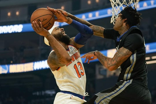 Dec 11, 2019; San Francisco, CA, USA; New York Knicks forward Marcus Morris Sr. (13) shoots against Golden State Warriors center Willie Cauley-Stein (2) during the first quarter at Chase Center. Mandatory Credit: Stan Szeto-USA TODAY Sports