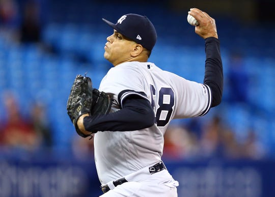 Dellin Betances #68 of the New York Yankees delivers a pitch in the fourth inning during a MLB game against the Toronto Blue Jays at Rogers Centre on September 15, 2019 in Toronto, Canada.
