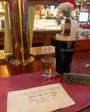 Jersey City police officers left a beer and a shot for fallen officer Joseph Seals.