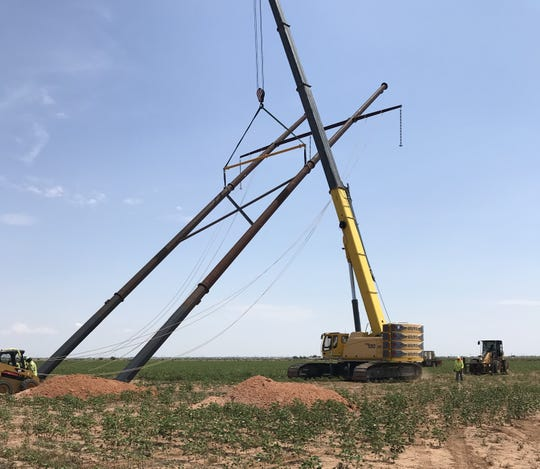 A 345-kilovolt transmission structure being raised along the route of the TUCO-Yoakum segment of Xcel Energy's Texas transmission line project.