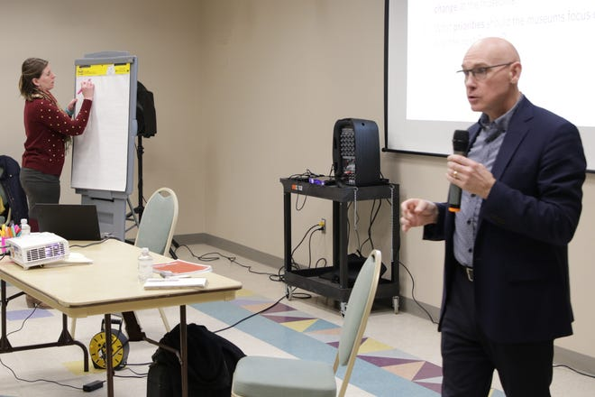 Senior consultant Sarah Hill of Lord Cultural Resources keeps track of audience feedback while vice president Brad King poses a question during a public meeting at the Farmington Museum at Gateway Park on Dec. 11, 2019.