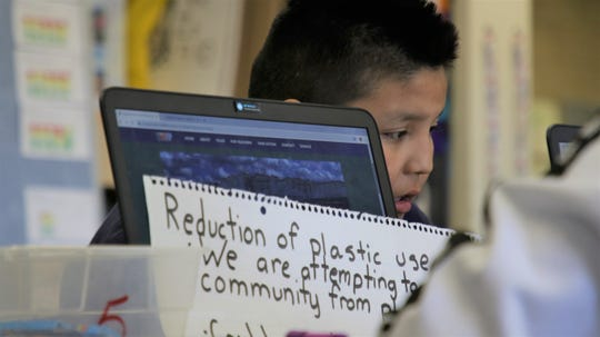 Racine Uentillie works on a group project using STEM skills to address issues in their communities at Ojo Amarillo Elementary on Dec. 12, 2019.