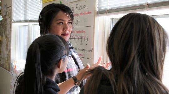 Adriane Jopek, 6th grade teacher at Ojo Elementary School, talks to two of her students on Dec. 12, 2019 about group projects they're working on revolving around using STEM skills to address issues in their community.