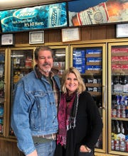 Mike and Denni Cheney in the package store portion of their business.