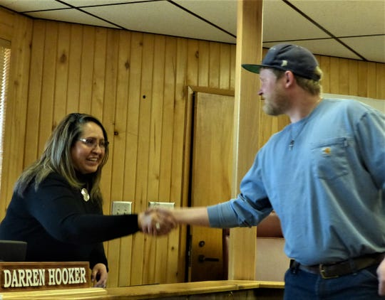 Carson Cleavinger  is welcomed to the village by Village Clerk Irma Devine.