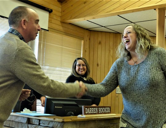 Alessa Mize , who joined the Ruidoso Police Department, shakes hands with Deputy Village Manager Ron Sena.