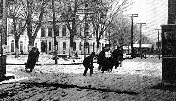 Both young and young-at-heart citizens participated in the snowball fight on the corner of Landry and Court streets in downtown Opelousas on Feb. 25, 1914. This was an eventful day in town with the first snow in 15 years, and the parish seat was almost completely shut down for an entire day.