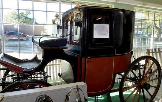 A carriage that has been a fixture at J.B. Sandoz was sold as the store prepared to close down.