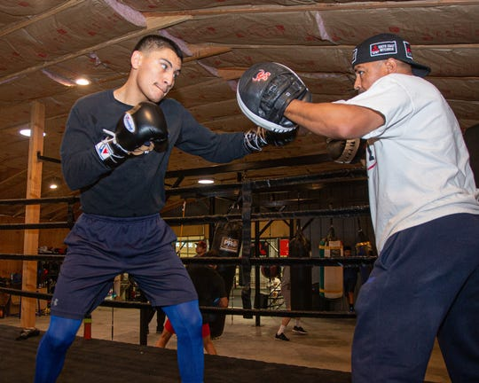 Boxer Vergil Ortiz works with his trainer and father in preparation for his Friday fight at Fantasy Springs.
