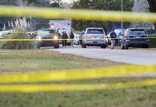 Law enforcement officers respond to the scene where an Escambia County Sheriff's Office deputy was shot Wednesday on Limerick Lane in Pensacola.