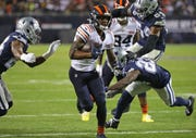 Anthony Miller #17 of the Chicago Bears runs between Chidobe Awuzie #24 (left) and Darian Thompson #23 of the Dallas Cowboys on hos way to a touchdown at Soldier Field on Dec. 05, 2019, in Chicago. The Bears defeated the Cowboys 31-24.