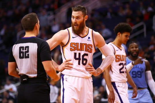 Phoenix Suns center Aron Baynes (46) talks to official JB DeRosa (62) against the Memphis Grizzlies in the second half on Dec. 11, 2019 in Phoenix, Ariz.