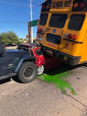 Tempe City Council candidate Marc Norman was involved in a car accident when a Jeep Wrangler rammed into his car, sending it under a school bus, on Tuesday, Dec. 10.