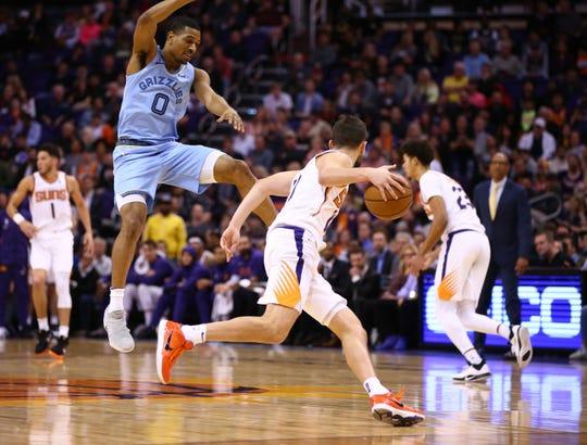 Memphis Grizzlies guard De'Anthony Melton (0) pressures Phoenix Suns guard Ty Jerome (10) in the second half on Dec. 11, 2019 in Phoenix, Ariz.
