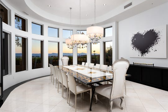 The $2.35M estate, purchased by Ahmed Shams, features a circular-style formal dining room.