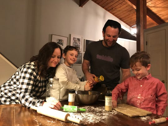 The D'Aleo family, from left to right: Nikki, Owen, Jared and Nate work on a gingerbread house.