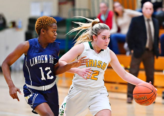 Linden Hall's Naomi Brabham, left, stays on York Catholic's Samantha Bulik as she drives the ball down the court during girls' basketball action at York Catholic High School, Wednesday, Dec. 11, 2019. Dawn J. Sagert photo
