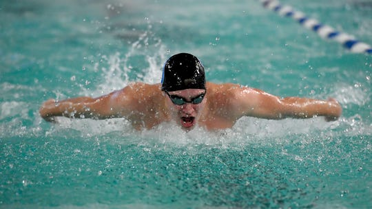 York Suburban's Matt Peters swims the butterfly leg of the 200 individual medlay at Dallastown, Thursday, December 12, 2019.