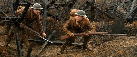 "Dean-Charles Chapman, left, and George MacKay star in ""1917,"" directed by Sam Mendes. The movie will be released Dec. 25."