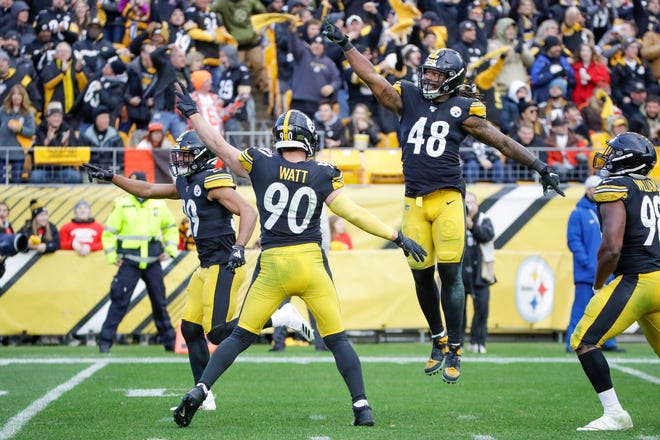 Pittsburgh Steelers outside linebacker Bud Dupree (48) outside linebacker T.J. Watt (90) and free safety Minkah Fitzpatrick (39) celebrate after recovering a fumble by Cleveland Browns quarterback Baker Mayfield (6)during the second half of an NFL football game, Sunday, Dec. 1, 2019, in Pittsburgh. (AP Photo/Gene J. Puskar)