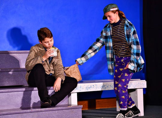 """Leroy Herdman (Riley Bell), right, steals the lunch bag of Charlie Bradley (Brock Gilson) during a dress rehearsal performance for TAFE's production of, """"The Best Christmas Pageant Ever,"""" at St. Mark's Lutheran Church in York City, Wednesday, Dec. 11, 2019. Dawn J. Sagert photo"""