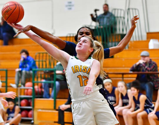 York Catholic's Samantha Bulik, front, takes the ball to the hoop while Linden Hall's Favour Mbeledeogu defends during girls' basketball action at York Catholic High School, Wednesday, Dec. 11, 2019. Dawn J. Sagert photo
