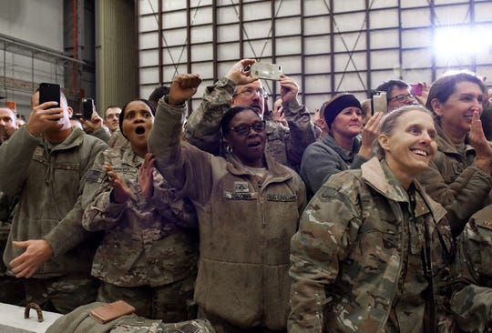 US Soldiers react with cheers and applause as US President Donald Trump arrives in Bagram Air Field during a surprise Thanksgiving day visit, on November 28, 2019 in Afghanistan. (Olivier Douliery/AFP via Getty Images)