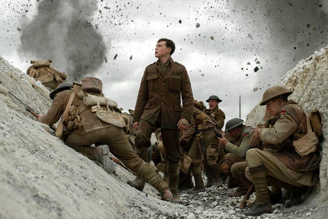 """George MacKay, center, stars in """"1917,"""" directed by Sam Mendes."""