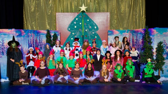 """The cast of the YIS """"Christmas Wizard of Oz"""" pose for a group photo."""