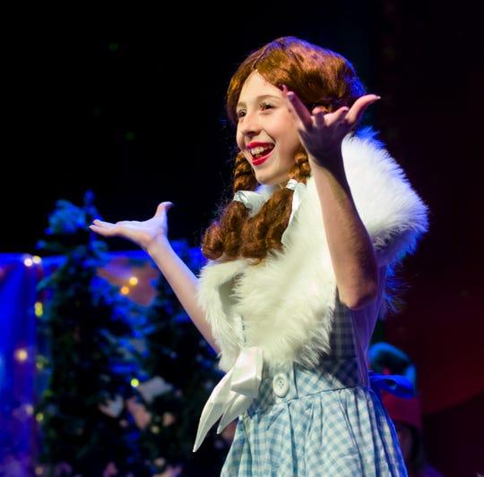Ellie Triplett plays Dorothy in the Christmas Wizard of Oz.