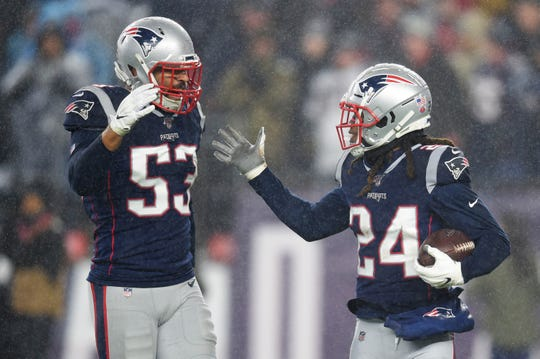 New England Patriots cornerback Stephon Gilmore (24) is congratulated by middle linebacker Kyle Van Noy (53) after making an interception during the first half against the Dallas Cowboys at Gillette Stadium.