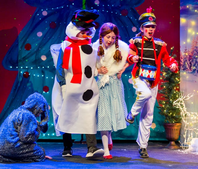 Colby Rowe, as Snowman, Ellie Triplett, as Dorothy, and Ella Kilgore, as Tin Soldier, dance off to find Oz.