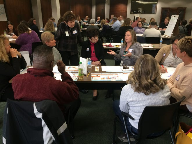 Pat Heiny, co-chair of the Early Childhood Coalition for Wayne County Kids, listens to the discussion of a group considering the early assessment of barriers to educational success for a child.
