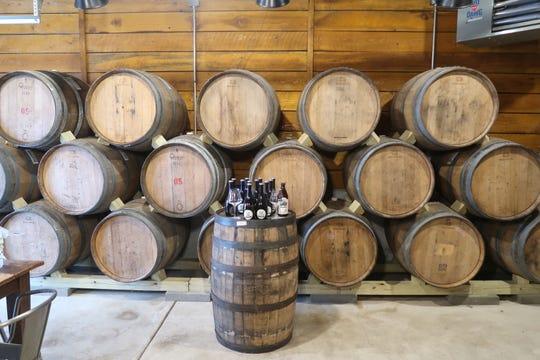 A wall of barrels inside the 42 Below Barrel House in East Aurora.