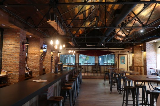 The cozy main seating area inside the 42 North Brewing taproom.