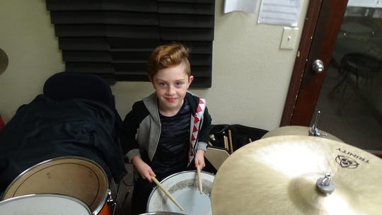"Logan Goekler, 7,  started ""playing"" the drums at age one. By age two, he was playing rhythms."