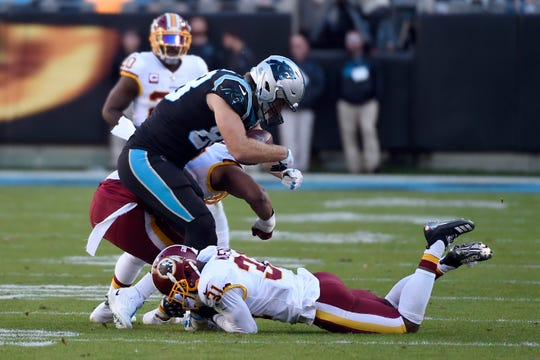 Carolina Panthers tight end Greg Olsen is hit by Washington Redskins linebacker Ryan Anderson, rear, and cornerback Fabian Moreau (31) during the second half of an NFL football game in Charlotte, N.C., Sunday, Dec. 1, 2019. Olsen was injured on the play, Anderson was disqualified for the remainder of the game.
