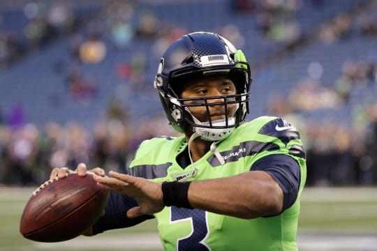 Seattle Seahawks quarterback Russell Wilson warms up before an NFL football game against the Minnesota Vikings, Monday, Dec. 2, 2019, in Seattle.