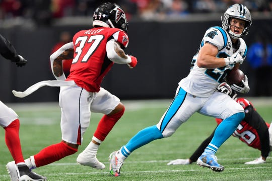 Carolina Panthers wide receiver D.J. Moore (12) runs against Atlanta Falcons free safety Ricardo Allen (37) during the first half of an NFL football game, Sunday, Dec. 8, 2019, in Atlanta.