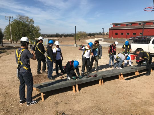 Rancho Cielo Youth Campus students enrolled in the GRID Alternatives program practice installing solar panels on a mimic roof in this undated photo.