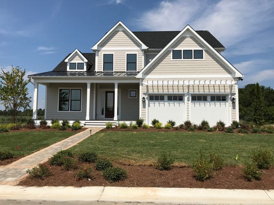 Exhibit A:  A model home with a driveway to the garage. A driveway is usually put in once a model home is sold.