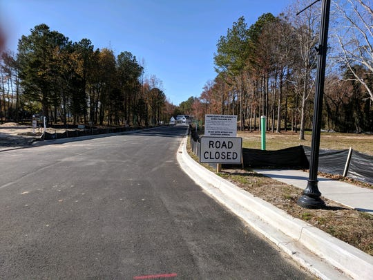 """Exhibit B: A """"Road Closed"""" sign at the site of a new home building project."""