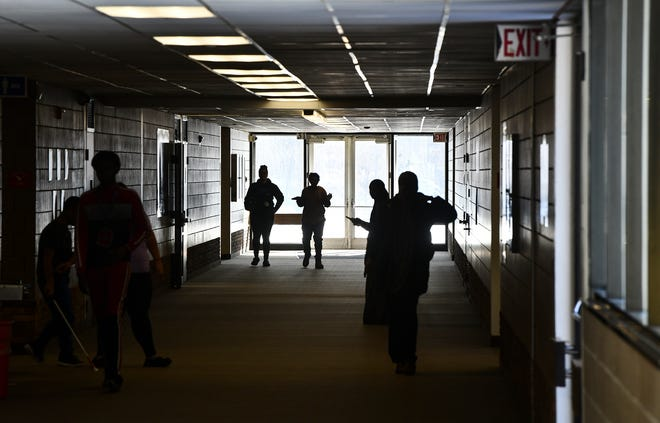 Students make their way down a long hallway between classes at Apollo High School Wednesday, Dec. 11, 2019, in St. Cloud.