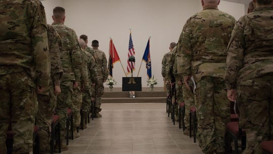 Members of the 34th Expeditionary Combat Aviation Brigade stand at a memorial ceremony for three guard members who died in a helicopter accident, Dec. 8, 2019, in Fort Hood , Texas